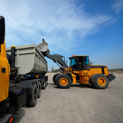 diesel loader will load construction crushed stone.