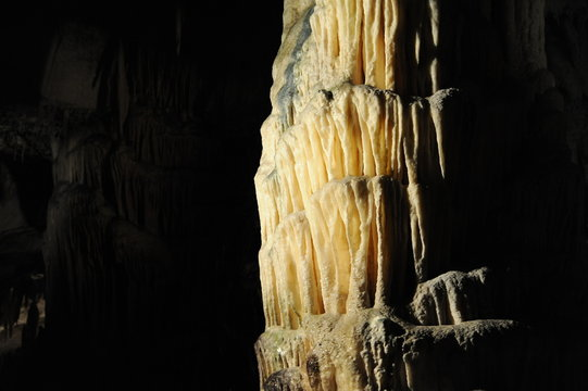 underground view of stalactites and stalagmites in natural halls in Postojna cave, Slovenia, Europe