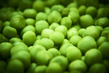 Fresh green peas background texture top view