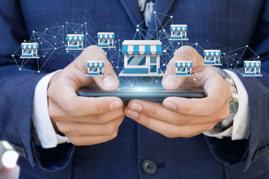 Businessman showing Franchise system on a mobile .