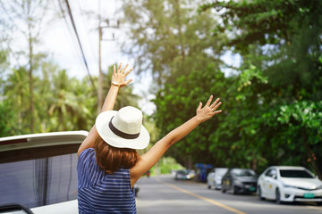 close up traveller young woman raise and outstretch arm for calling some vehicle to pick up to destination, lifestyle concept