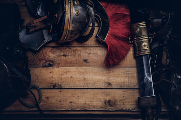 Complete combat equipment of the ancient Greek warrior on a wooden boards.