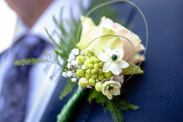 Corsage from man groom suit on wedding day.