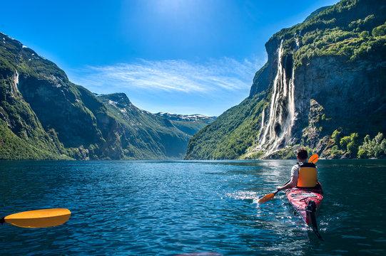 man kayaking along the fjord