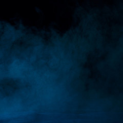 mysterious blue vapor like a mist on a dark background