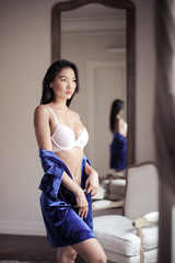Charming woman wearing fashionable lingerie
