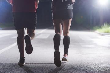Fototapeta runners team on the night training obraz