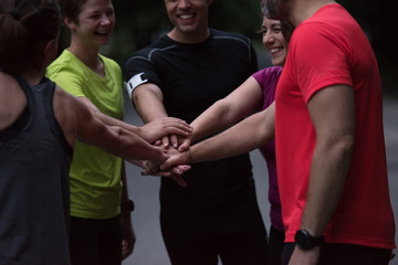 runners giving high five to each other