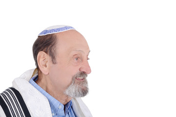 Eldery jewish man wrapped in talit praying