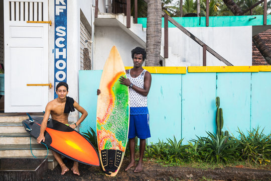 Two men with surfboards