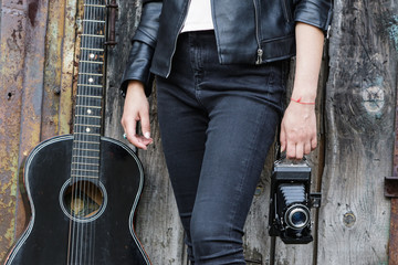 Girl with a guitar and an old camera