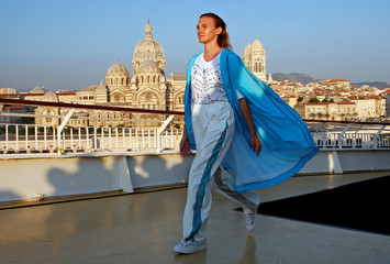 A model presents a creation by designer Christelle Kocher as part of her 2019 Cruise collection show for Maison Koche on board the Danielle Casanova cruise-ferry in Marseille