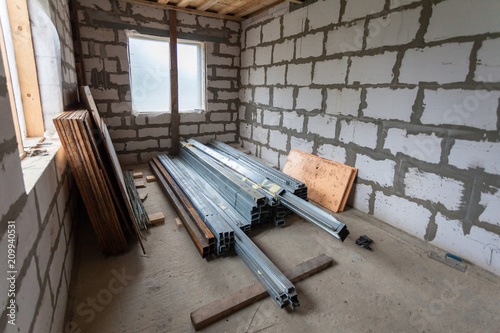 Working process of installing metal frames for plasterboard drywall ...