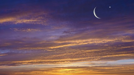 Crescent moon with Stars . Crescent moon with beautiful sunset background . Generous Ramadan .  new moon .