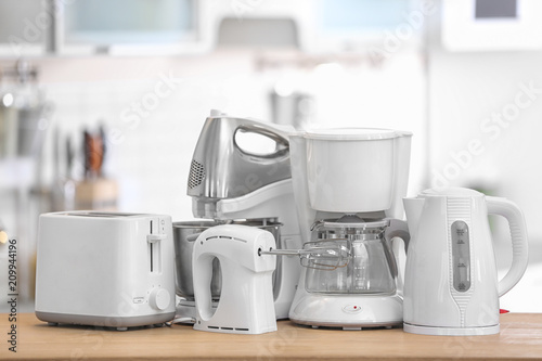 Different modern kitchen appliances on table indoors. Interior ...
