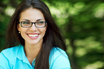 Beautiful smiling woman in glasses - close up
