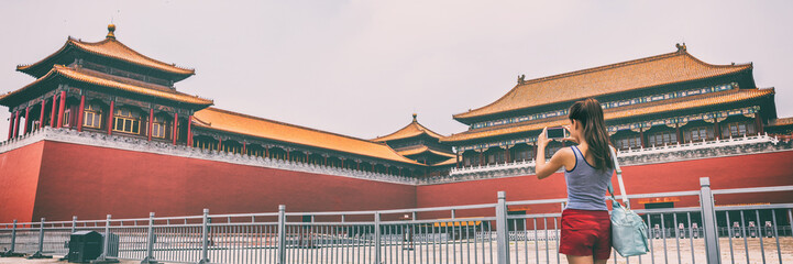 Wall Mural - Forbidden City Asia travel tourist in Beijing, China summer vacation banner panorama lifestyle. Asian woman taking picture with phone of Beijing touristic attraction, famous chinese landmark.