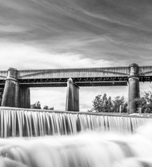 Neutral Density Black and white shout of a waterfall infront of train bridge, NSW, Australia