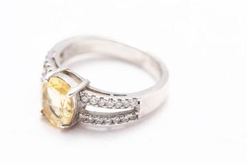 Yellow gem stone on diamond ring