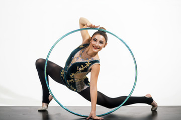 Aluminium Prints Gymnastics Woman train acrobatics with hula hoop in sportswear. Sport success and health. Woman with gymnastic ring. Workout sports activities in gym of flexible girl. Fitness and dieting of girl gymnast