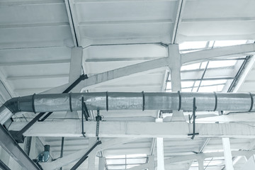 ceiling of industrial building with ventilation system inside bottom view