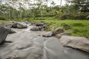Nature river in long exposure shot, Kaliurang, Yogyakarta, Indonesia. June 2018