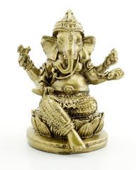 Gilded figure of the elephant Ganesha on white background