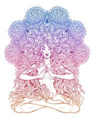 Beautiful girl in lotus position with long hair with beautiful mandala.