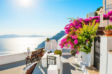 Tuinposter Eiland Beautiful terrace with pink flowers on Santorini island, Greece