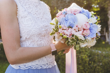 Wedding. Bridal bouquet in the hands