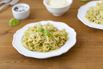 Pasta Farfalle in pesto sauce with Basil and Parmesan.