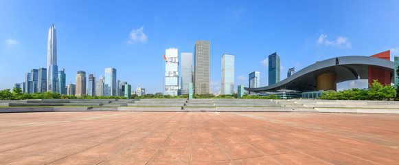 Empty square floor and modern city commercial architecture panorama in shenzhen,China