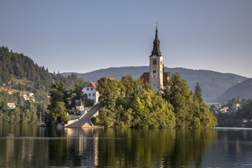 Island in lake Bled in foggy morning light