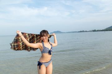 Teenage wearing bikini at the beach.