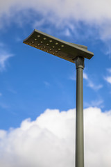 Black LED street light blue sky