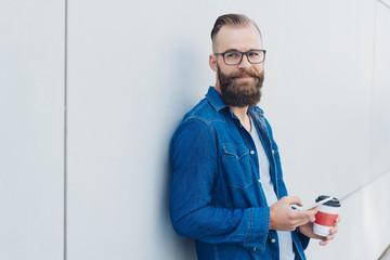 Friendly bearded man wearing glasses
