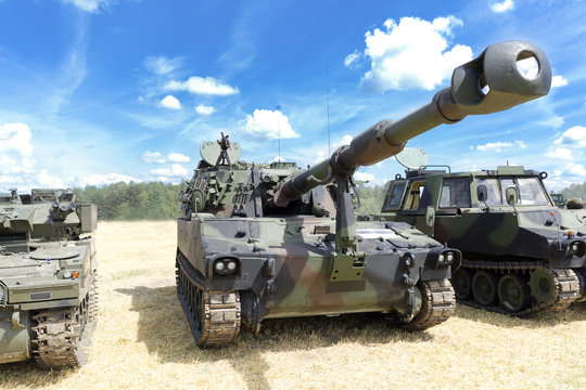 Heavy military equipment exhibition. Army tank with guns