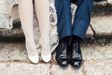 Bride and groom wedding shoes close up