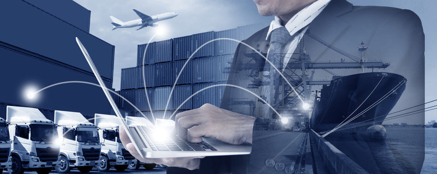 Shipping, Logistics background by multiple exposures of business man is working by using laptop to control his work.