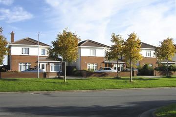 three identical cottages, a suburb street, Ireland