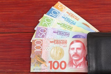 Money from New Zealand in the black wallet