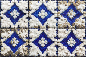 Traditional Portuguese azulejo tiles on the building in Porto, Portugal.
