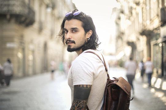 Handsome alternative guy walking in the city