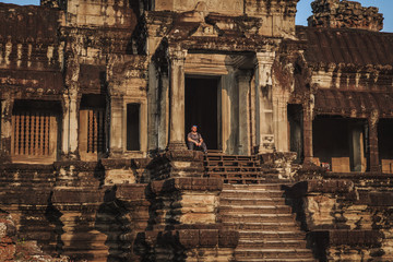 Tourist in the temple of Angkor Wat. Siem Reap, Cambodia.