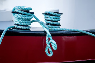 Rope tied in a knot on a bollard