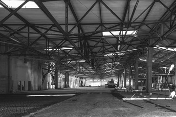 the interior of a large industrial building in the process of construction black and white photo