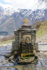 Water spring in Holy Trinity Church near the village of Gergeti, Georgia