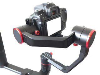 object for smooth video production make movie . isolated on white background . camera stabilizer automatic functions . professional film maker with gimbal . hand held shake motor system . black dslr