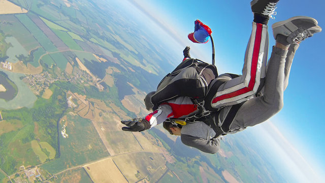 Skydiving tandem jumping out of a plane