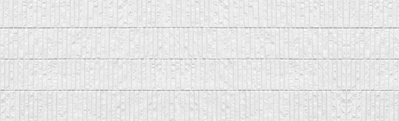 Panorama of Modern white stone tile wall background and pattern